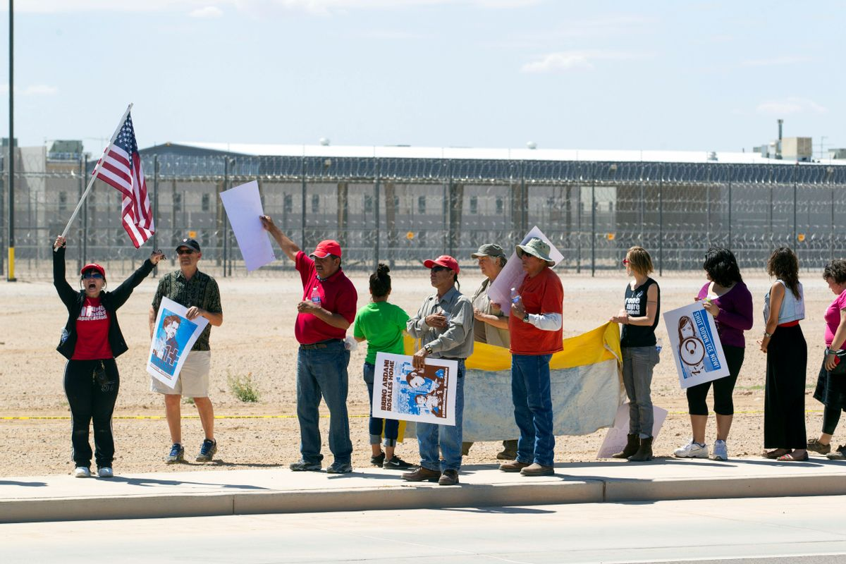 FILE - In this April 5, 2014, file photo, supporters of the immigrant advocacy group, Puente Movement, demonstrate outside the U.S. Immigration and Customs Enforcement detention center in Eloy, Ariz.  (AP)