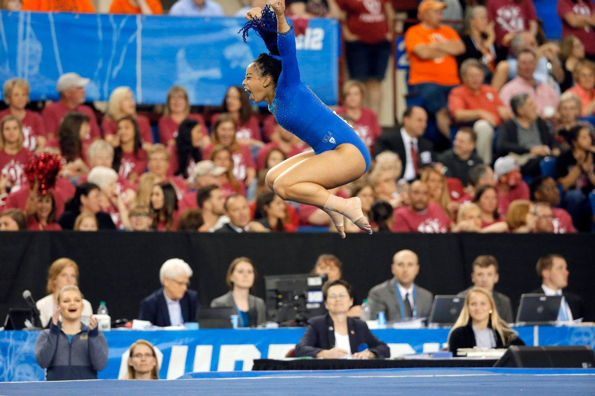 FILE - In this April 16, 2016, file photo, UCLA's Sophina DeJesus celebrates after her floor exercise routine during the NCAA women's gymnastics championships in Fort Worth, Texas. (AP Photo/Tony Gutierrez, File) (AP)