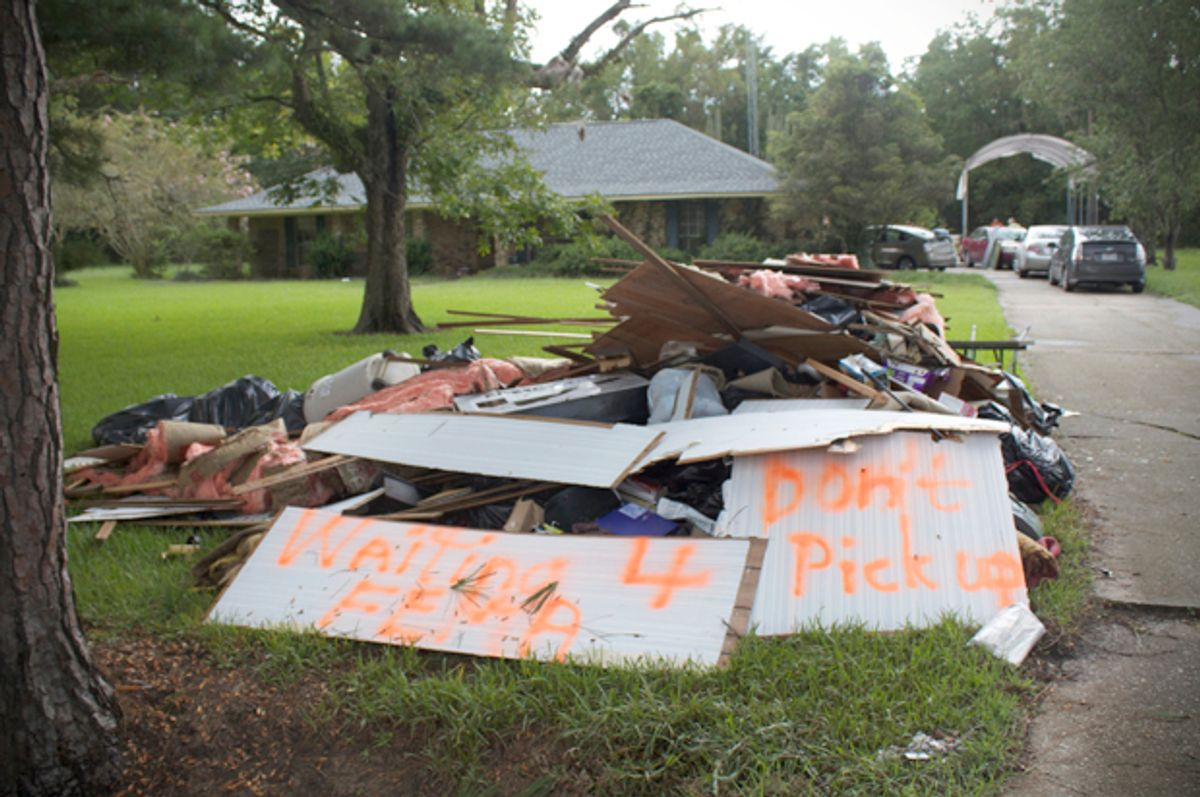 Debris piled up from flooded home on Hodgeson Road in Prairieville, Louisiana  on Sunday (Lisa O'Neill)