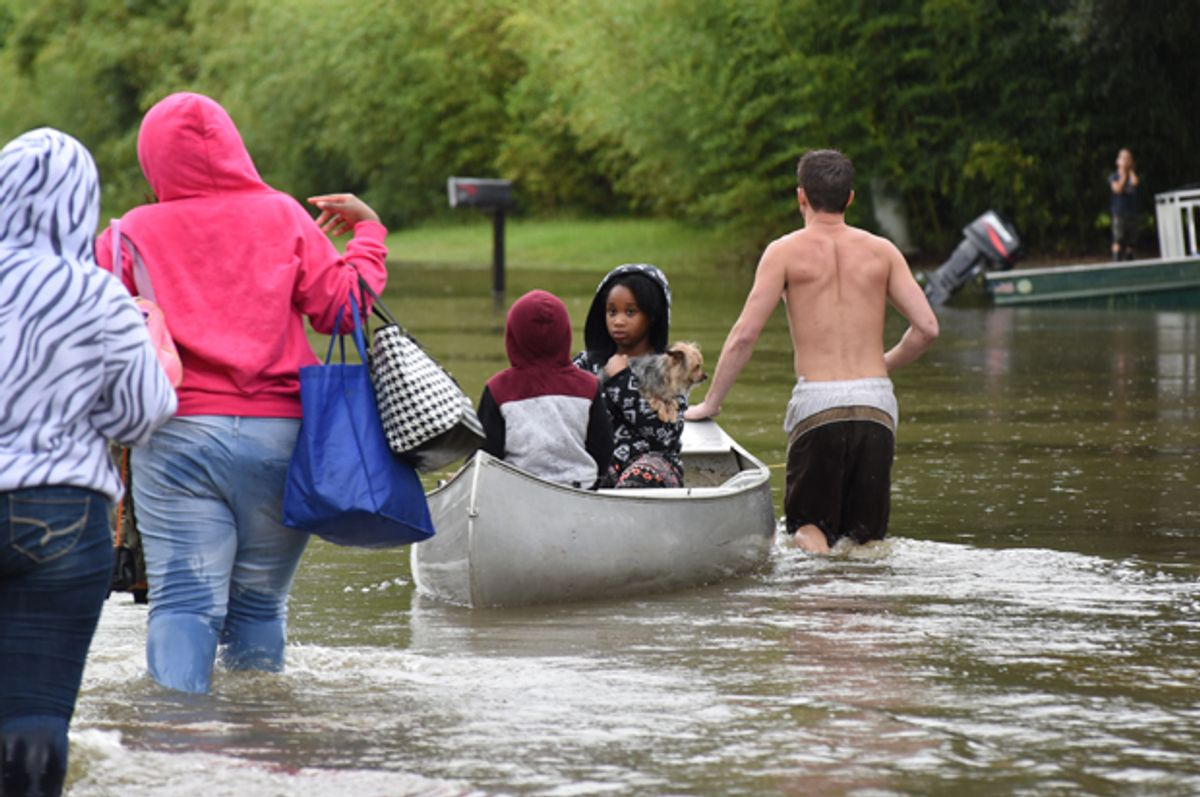 A young girl silently looks back at her family after being rescued from floodwaters that overtook Comite Drive and the surrounding neighborhoods in Central on Saturday.   (The Advocate/Caroline Ourso)