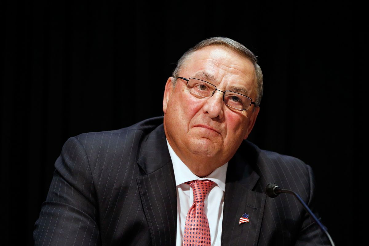 FILE- In this June 7, 2016, file photo, Maine Gov. Paul LePage attends an opioid abuse conference in Boston. LePage is being accused again of making racially insensitive comments, this time by saying photos he's collected in a binder of drug dealers arrested in the state show more than 90 percent of them are black or Hispanic. The governor made the remark at a town hall in North Berwick, Maine, Wednesday, Aug. 24, 2016. (AP Photo/Michael Dwyer, File) (AP)