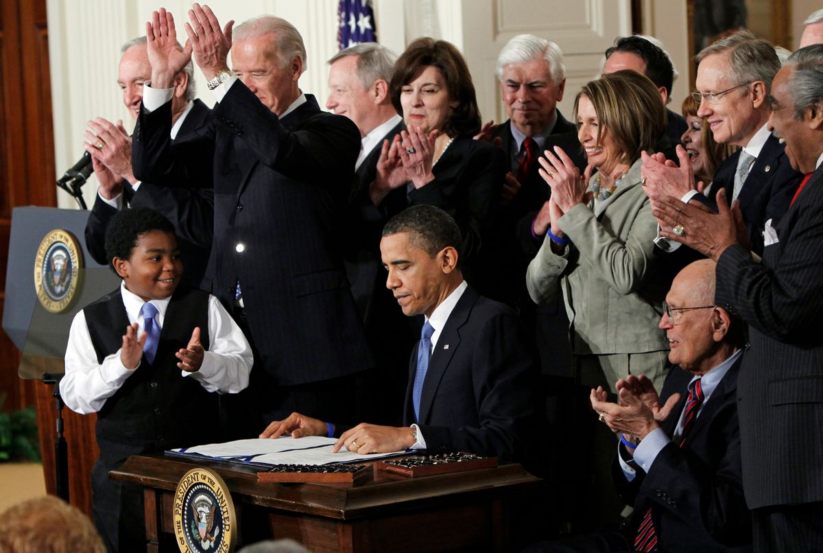 FILE - In this March 23, 2010, file photo President Barack Obama is applauded after signing the Affordable Care Act into law in the East Room of the White House in Washington. (AP Photo/Charles Dharapak, File) (AP)
