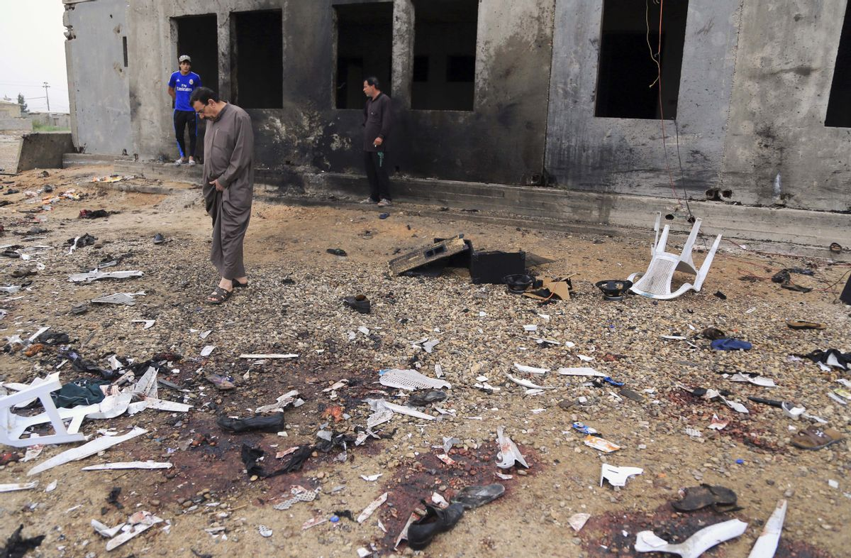 FILE - In this March 26, 2016, file photo, people inspect the aftermath of a suicide bombing that killed 29 and wounded 60 at a soccer field in Iskandariya, 25 miles (about 40 kilometers) south of Baghdad, Iraq. The Islamic State group claimed responsibility and released a photo of the attacker where he appears to be no more than 16 years old. The suicide attacker who detonated his explosives amid an outdoor Kurdish wedding party, Saturday, Aug. 20, 2016, in southeastern Turkey, killing at least 51 people, was an Islamic State group child as young as 12 years old. (AP Photo/Karim Kadim, File) (AP)