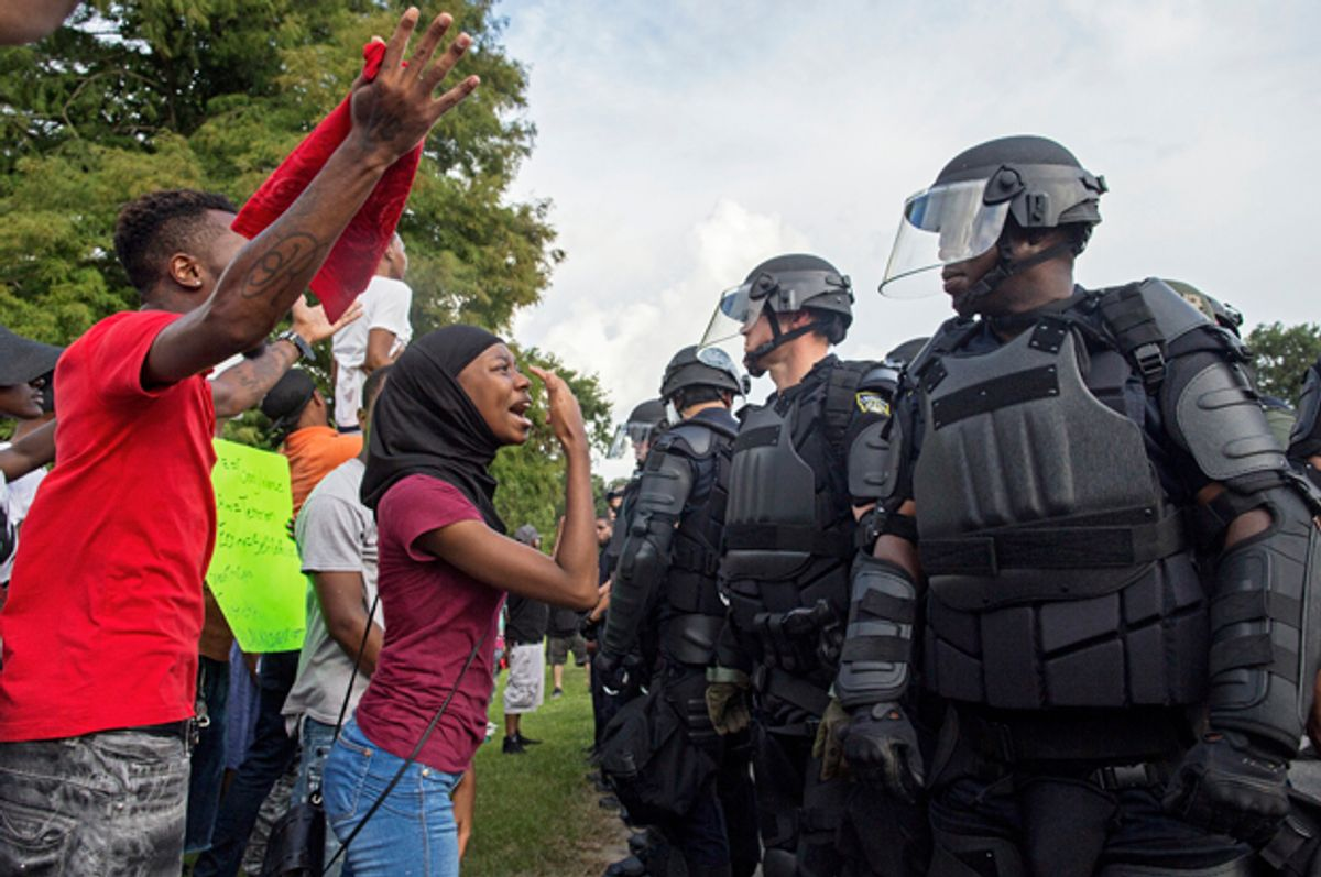 Protesters confront police officers in Baton Rouge, July 9, 2016.    (AP/Max Becherer)
