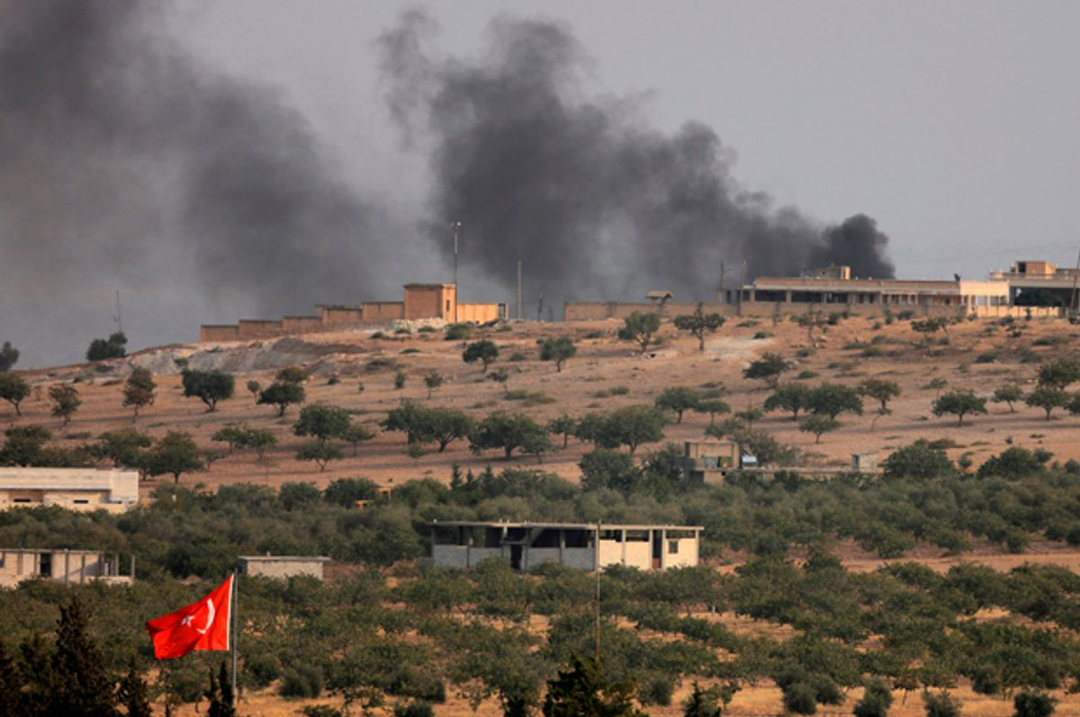 Smoke rises from the Syrian border town of Jarablus as it is pictured from the Turkish town of Karkamis, Turkey, August 24, 2016.   (Reuters/Umit Bektas)