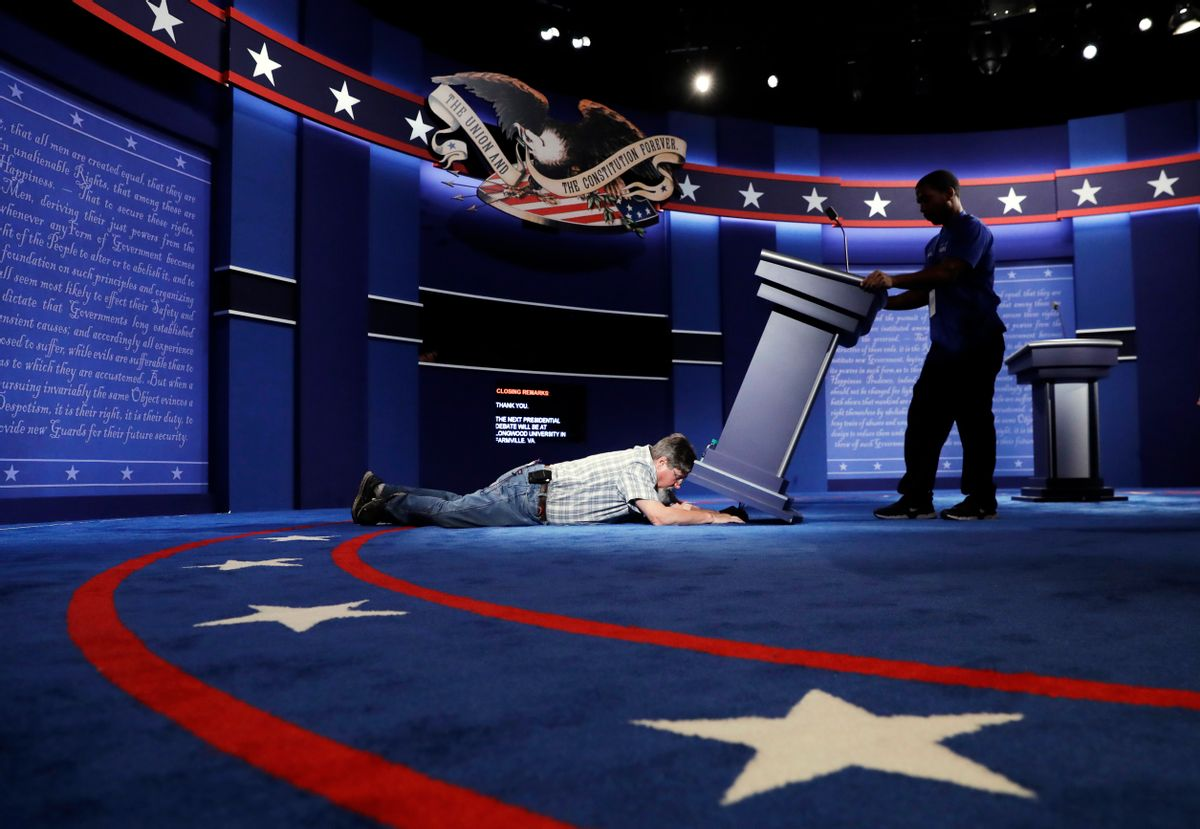Technicians set up the stage for the presidential debate between Democratic presidential candidate Hillary Clinton and Republican presidential candidate Donald Trump. (AP)