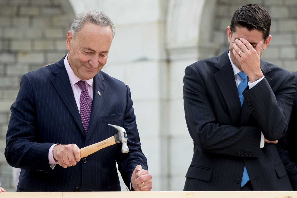 House Speaker Paul Ryan of Wis., right, hides his face and laughs at Sen. Charles Schumer, D-N.Y., bends his nail during a ceremony to drive in the first nails to signifying the start of construction on the 2017 presidential inaugural platform, Wednesday, Sept. 21, 2016, on Capitol Hill in Washington. (AP Photo/Andrew Harnik) (AP)