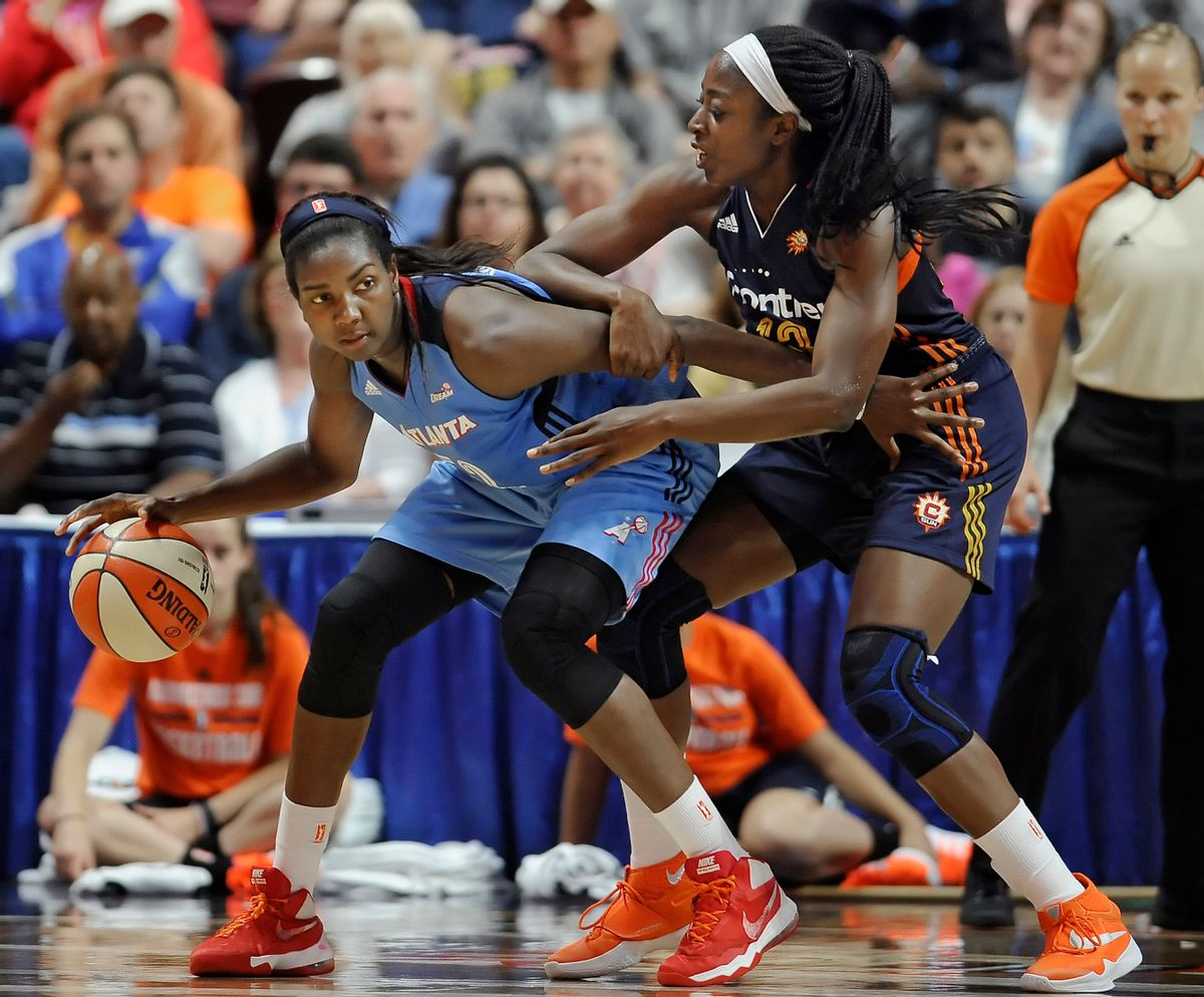 FILE - In this July 10, 2016, file photo, Atlanta Dream's Elizabeth Williams, left, is guarded by Connecticut Sun's Chiney Ogwumike during the second half of a WNBA basketball game in Uncasville, Conn. Atlanta's Elizabeth Williams was voted the most improved player, Tuesday, Sept. 20, 2016. (AP Photo/Jessica Hill, File) (AP)