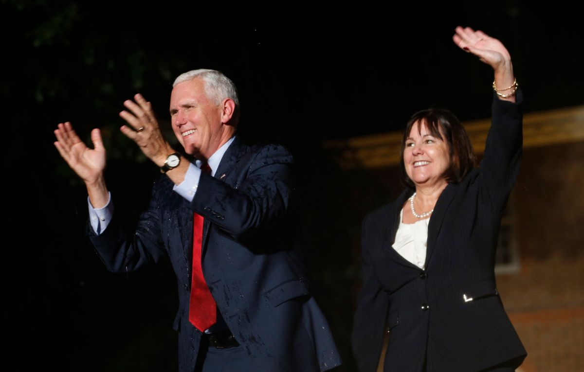 Republican vice presidential candidate Indiana Gov. Mike Pence, and his wife Karen, right,. (AP)
