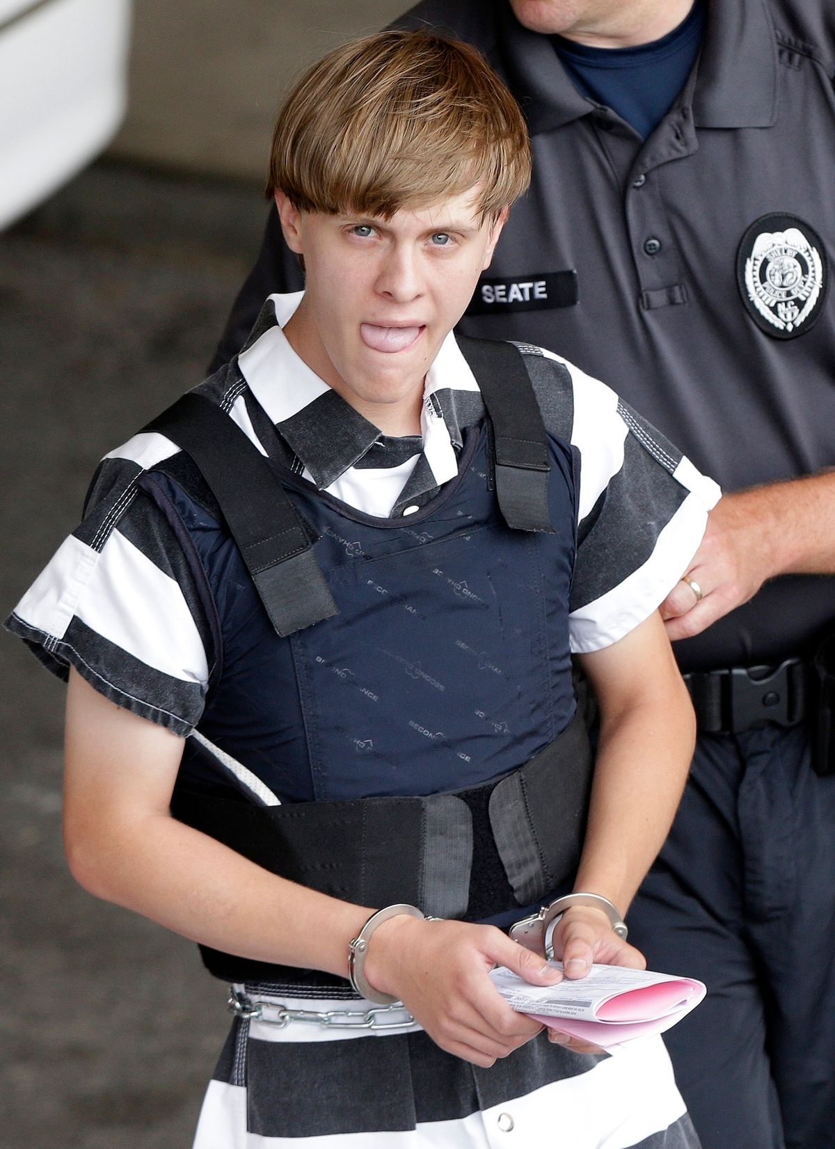 FILE - In this Thursday, June 18, 2015, file photo, Charleston, S.C., shooting suspect Dylann Roof is escorted from the Cleveland County Courthouse in Shelby, N.C. T (AP)
