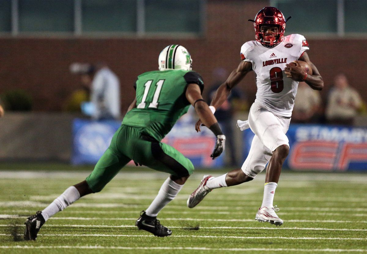 FILE - In this Sept. 24, 2016., file photo, Louisville quarterback Lamar Jackson (8) runs the ball as Marshall's Rodney Allen (11) closes in during the first half of an NCAA college football game in Huntington, W. Va. Third-ranked  Louisville can take a commanding lead in the ACC Atlantic race when play No. 5 Clemson on Saturday. (AP Photo/Walter Scriptunas II, File) (AP Photo/Walter Scriptunas II, File)