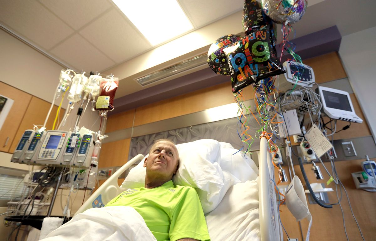 Sportscaster Craig Sager lies in his bed while receiving a transplant Wednesday, Aug. 31, 2016, at MD Anderson Cancer Center in Houston. After a battle with acute myeloid leukemia, Sager passed away in 2016 shortly after his third bone marrow transplant. (AP Photo/David J. Phillip) (AP)