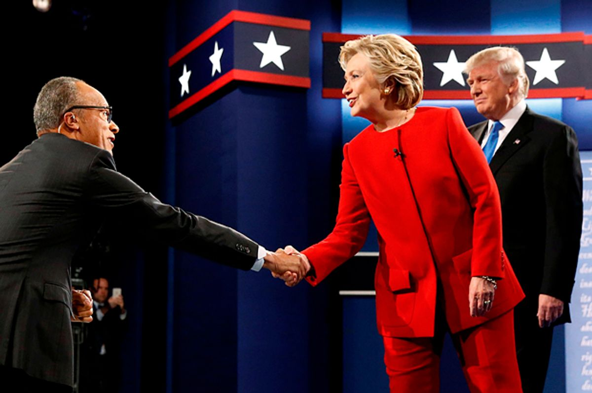Hillary Clinton greets moderator Lester Holt of NBC News as she and Donald Trump take the stage for their first debate in Hempstead, New York, September 26, 2016.   (Reuters/Jonathan Ernst)