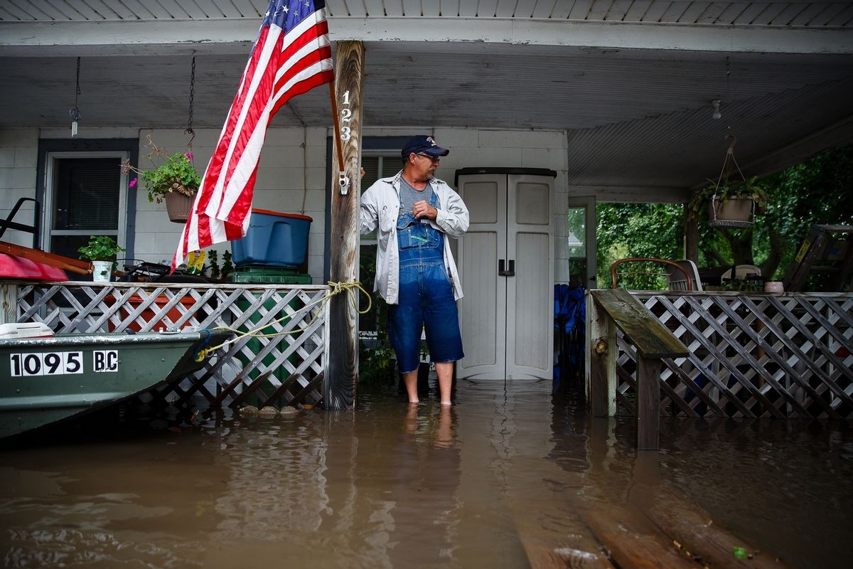Tom Moffitt stands on his deck as he looks at the flood waters on Friday, Sept. 23, 2016, in Shell Rock, Iowa. Authorities in several Iowa cities were mobilizing resources Friday to handle flooding from a rain-swollen river that has forced evacuations in several communities upstream, while a Wisconsin town was recovering from storms.   (Brian Powers/The Des Moines Register via AP  ) (AP)