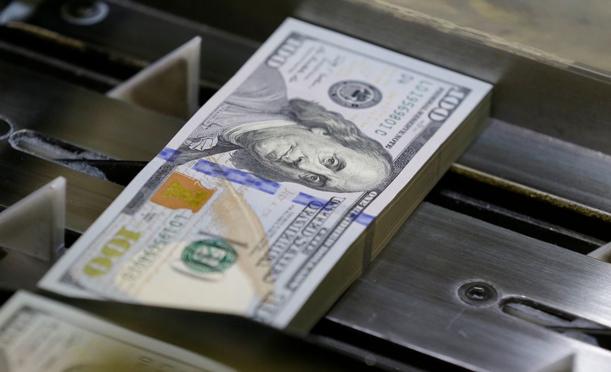 FILE - In this Tuesday, Sept. 24, 2013, file photo, a just-cut stack of $100 bills rolls down the line at the Bureau of Engraving and Printing Western Currency Facility in Fort Worth, Texas. Finding money you didn't know you had is like discovering lost treasure. Nearly $42 billion in unclaimed property is sitting in state coffers, waiting to be matched with its owners or their heirs. () (AP Photo/LM Otero, File)