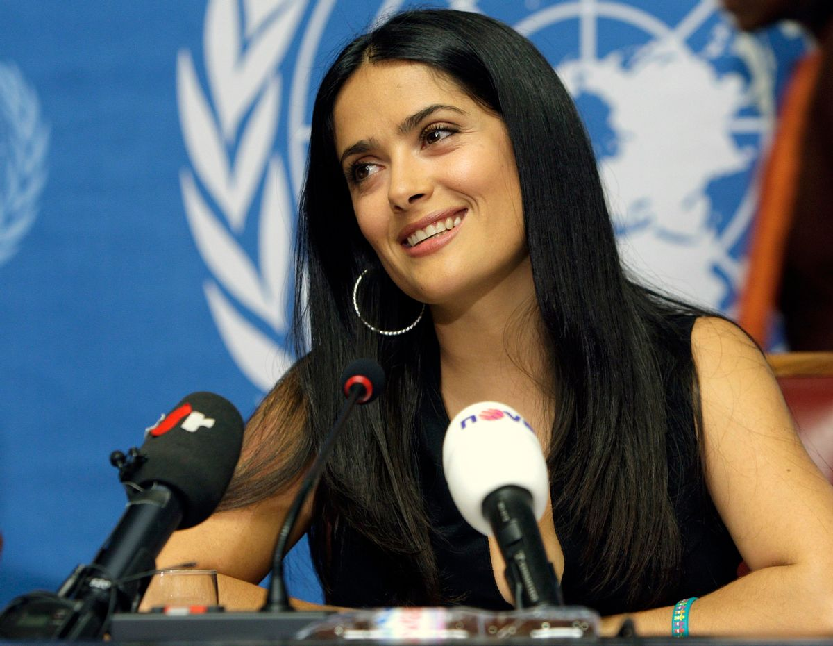 """Mexican actress Salma Hayek, spokeswoman for the global Pampers/UNICEF campaign """"One Pack = One Vaccine"""", reacts during a press conference to announce the partnership between UNICEF and Pampers aimed at eliminating maternal and newborn tetanus, at the United Nations building in Geneva, Switzerland, Thursday, Oct. 2, 2008. (AP Photo/Keystone, Martial Trezzini) (AP)"""