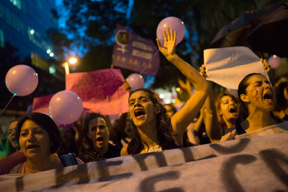 Women participate in a demonstration against gender violence in Rio de Janeiro, Brazil, Tuesday, Oct. 25, 2016. Women in Brazil organized protests condemning violence against women following the brutal gang rape of a woman on the outskirts of Rio de Janeiro by suspected drug dealers. (AP Photo/Leo Correa) (AP)