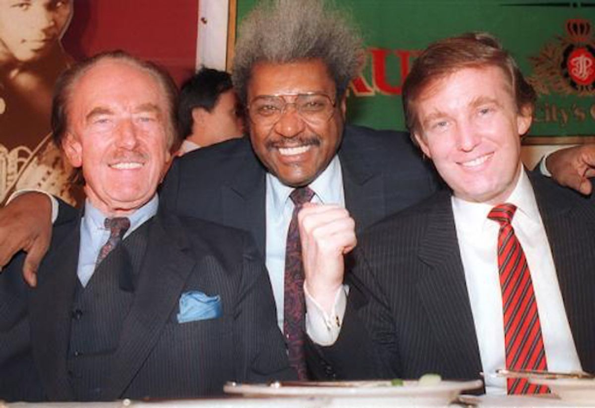 Donald Trump, right, pictured with his father, Fred Trump, far left, and boxing promoter Don King at a press conference in December 1987 in Atlantic City, NJ.  (AP Photo)