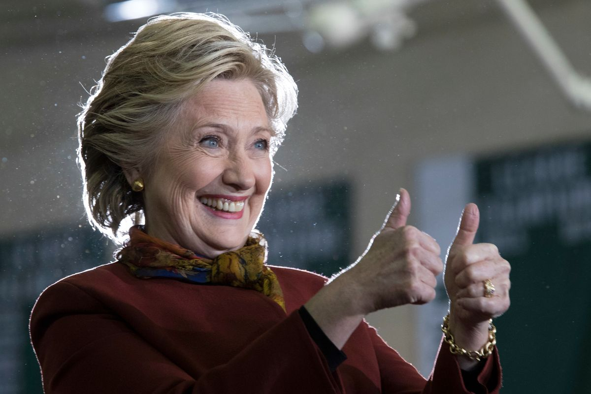 Democratic presidential candidate Hillary Clinton gestures at supporters during a campaign event at the Taylor Allderdice High School, Saturday, Oct. 22, 2016, in Pittsburgh, Pa.  (AP)