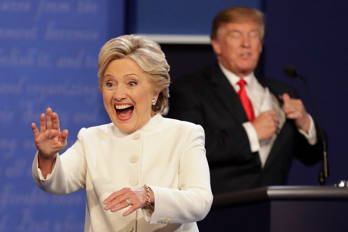 Democratic presidential nominee Hillary Clinton waves to the audience as Republican presidential nominee Donald Trump puts his notes away after the third presidential debate at UNLV in Las Vegas, Wednesday, Oct. 19, 2016. (AP Photo/John Locher) (AP)