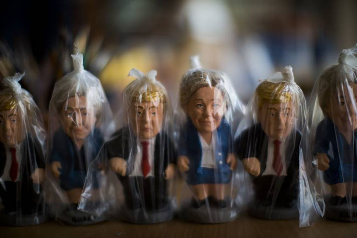 """In this Monday, Oct. 3, 2016 photo, miniatures of U.S. presidential candidates Hillary Clinton and Donald Trump are wrapped in plastic bags in a """"caganer"""" factory at Torroella de Montgri, northeast Catalonia, Spain.  A curious Christmas tradition in the Spanish autonomous region of Catalonia depicts both candidates in a rather scatological situation. The miniatures called """"Caganer"""", depict a person defecating, and traditionally symbolizes fertilization and a source of luck and prosperity in the new year. (AP Photo/Emilio Morenatti) (AP)"""