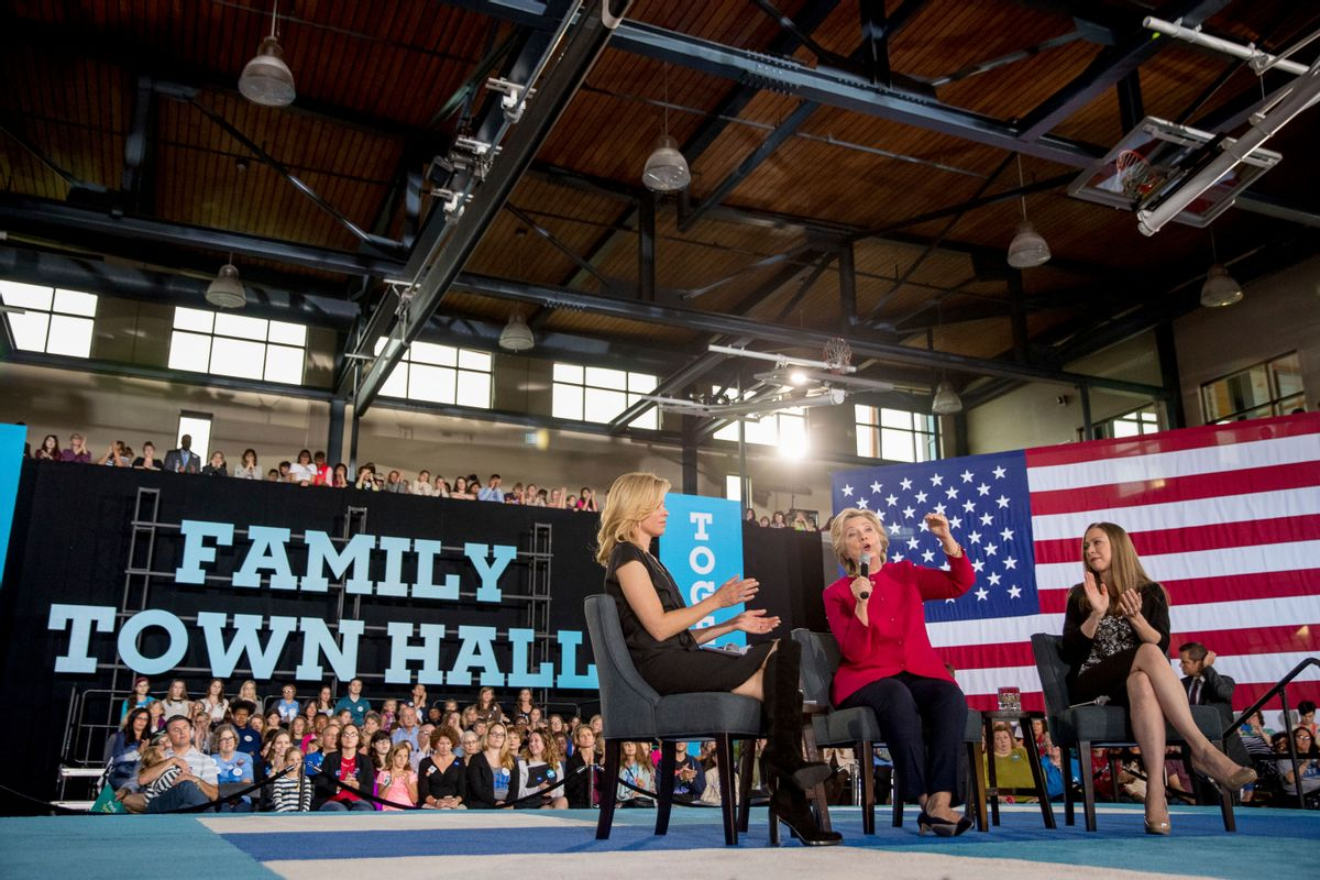 In this Oct. 4, 2016, photo, Democratic presidential candidate Hillary Clinton, center, accompanied by her daughter Chelsea Clinton, right, and actress Elizabeth Banks, speaks at a town hall at the Haverford Community Recreation and Environmental Center in Haverford, Pa. Even if your daughters don't pay much attention to politics, they'd be hard-pressed to have missed Donald Trump's attack of a former Miss Universe's weight or comments about a 400-pound hacker. It resonated with a 15-year-old who said this week the words damage girls' body image and asked Clinton how to help. (AP Photo/Andrew Harnik) (AP)