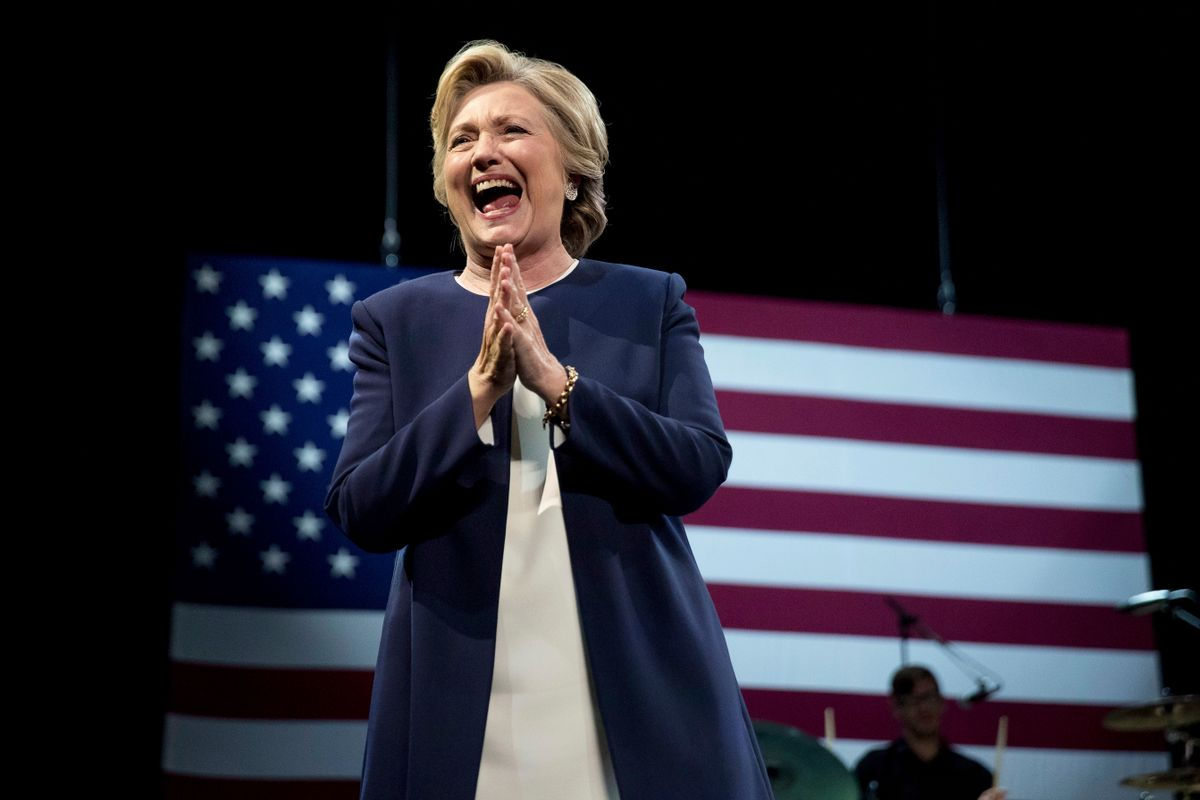 Democratic presidential candidate Hillary Clinton takes the stage at a fundraiser at the Civic Center Auditorium in San Francisco, Thursday, Oct. 13, 2016. (AP)