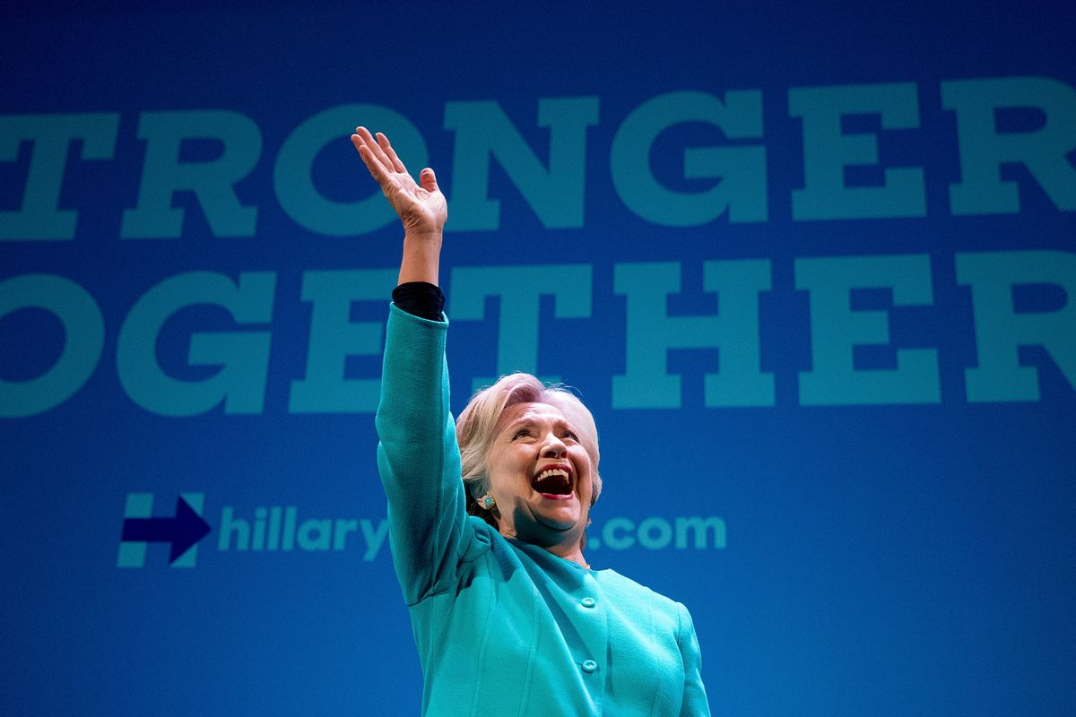 Democratic presidential candidate Hillary Clinton waves as she takes the stage to speak at a fundraiser at the Paramount Theatre in Seattle, Friday, Oct. 14, 2016. (AP Photo/Andrew Harnik) (AP)
