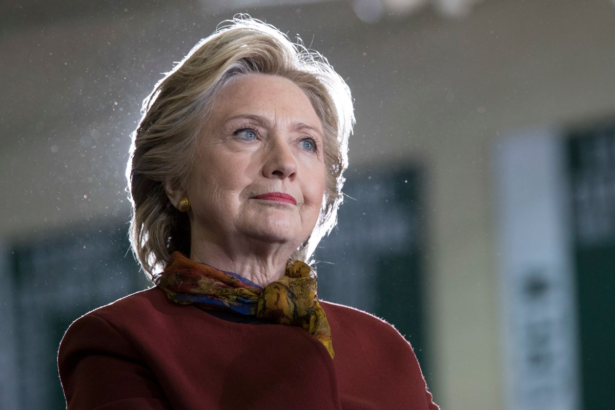 Democratic presidential candidate Hillary Clinton listens as vice presidential candidate Sen. Tim Kaine, D-Va. speaks during a campaign event at the Taylor Allderdice High School, Saturday, Oct. 22, 2016, in Pittsburgh, Pa.  (AP)