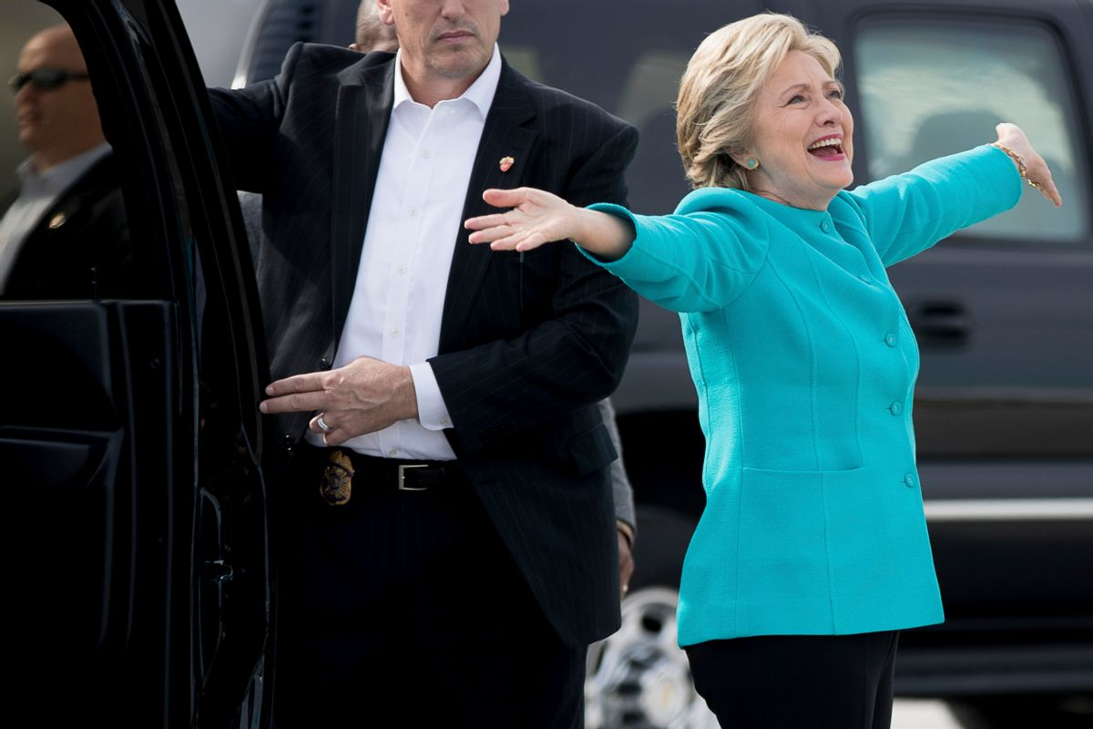Democratic presidential candidate Hillary Clinton reacts to a reporters questions about her birthday before boarding her campaign plane at Miami International Airport in Miami, Wednesday, Oct. 26, 2016, to travel to Lake Worth, Fla. for a rally. Clinton turns 69 today. (AP Photo/Andrew Harnik) (AP Photo/Andrew Harnik)