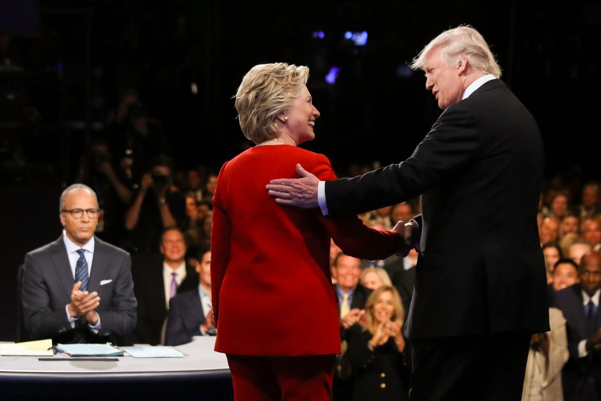 FILE - In this Sept. 26, 2016 file photo, Democratic presidential nominee Hillary Clinton and Republican presidential nominee Donald Trump shake hands during the presidential debate at Hofstra University in Hempstead, N.Y. For presidential candidates, the town hall debate is a test of stagecraft as much as substance. When Hillary Clinton and Donald Trump meet in the Sunday, Oct.9, 2016, contest, they'll be fielding questions from undecided voters seated nearby. In an added dose of unpredictability, the format allows the candidates to move around the stage, putting them in unusually close proximity to each other.  (Joe Raedle/Pool via AP, File) (AP)