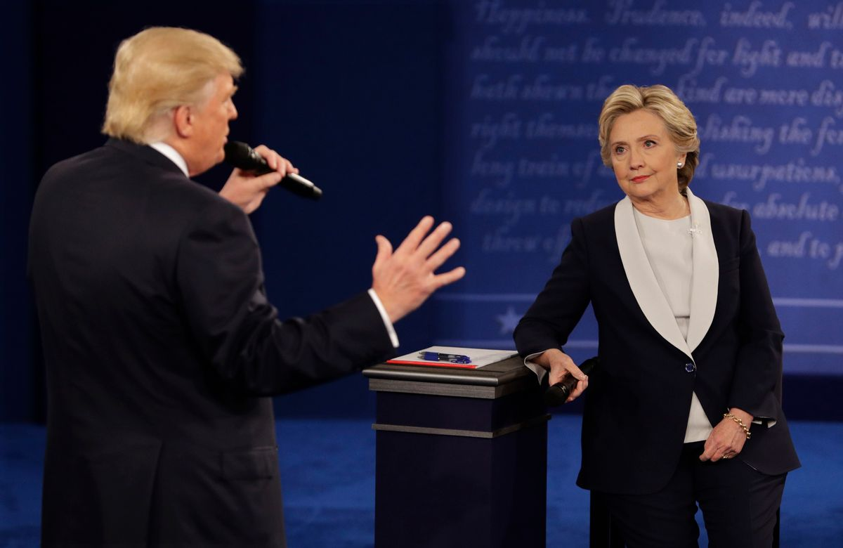 Democratic presidential nominee Hillary Clinton listens to Republican presidential nominee Donald Trump during the second presidential debate at Washington University in St. Louis, Sunday, Oct. 9, 2016. (AP Photo/John Locher) (AP)