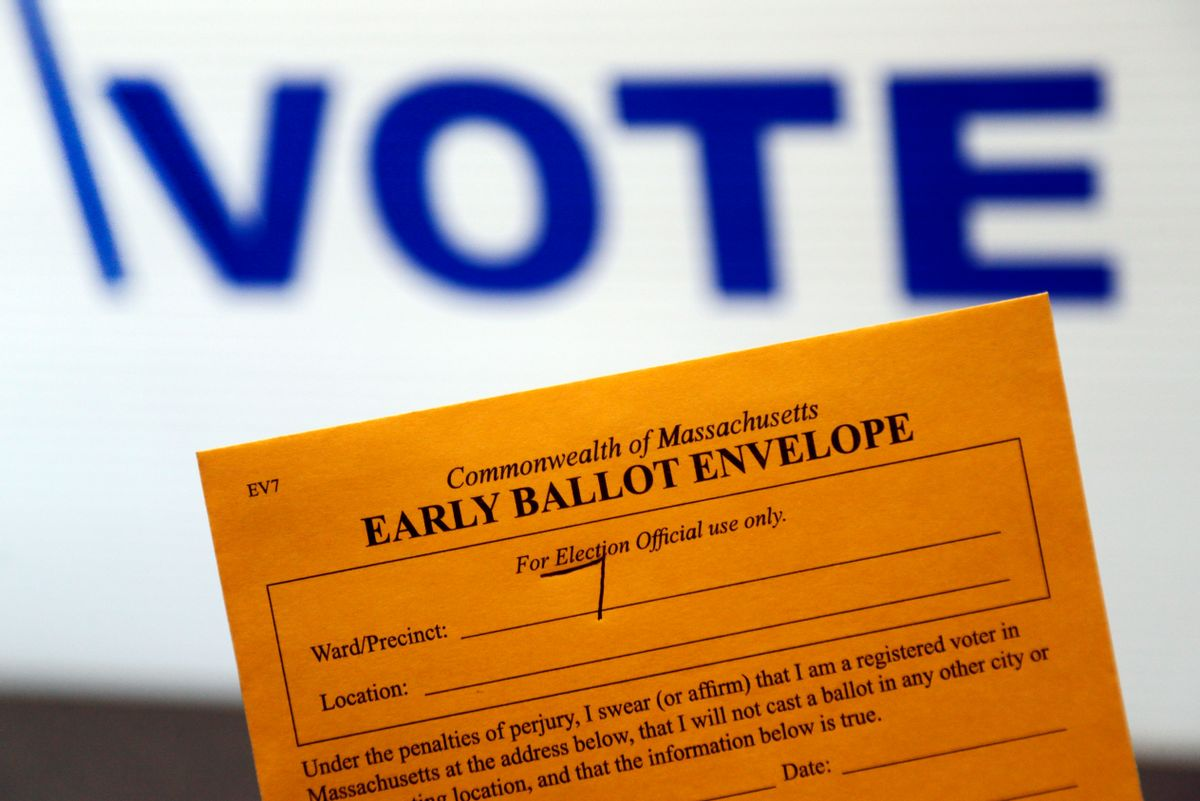 In this Oct. 24, 2016, photo, an early ballot envelope is held at town hall in North Andover, Mass. The millions of votes that have been cast already in the U.S. presidential election point to an advantage for Hillary Clinton in critical battleground states, as well as signs of strength in traditionally Republican territory. (AP Photo/Elise Amendola) (AP)
