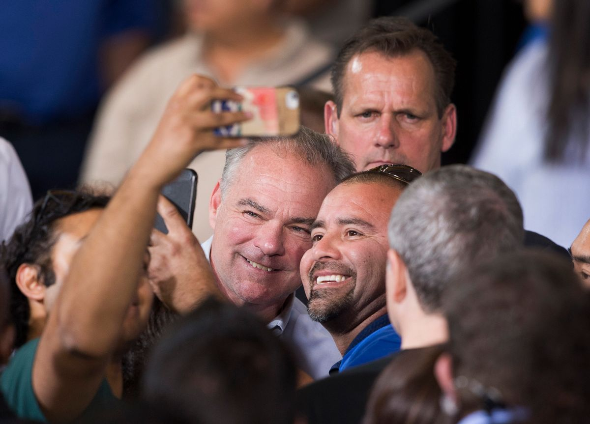 Democratic vice presidential nominee, Tim Kaine, center left, poses with a supporter during a Nevada Democratic Party rally at the Carpenters International Training Center in Las Vegas, Thursday, Oct. 6, 2016. (Steve Marcus/Las Vegas Sun via AP) (Steve Marcus/Las Vegas Sun via AP)