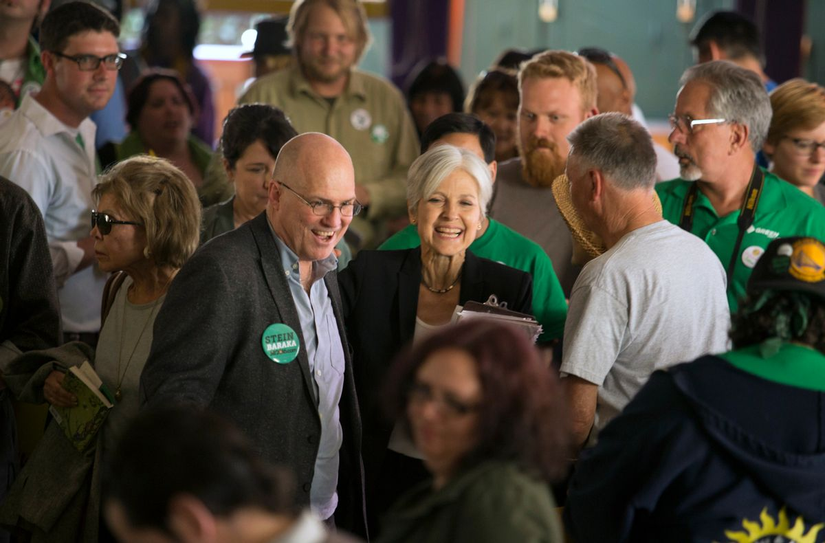 Accompanied by 2004 presidential candidate David Cobb, left, Green party presidential hopeful Jill Stein meets her supporters during a campaign stop at Humanist Hall in Oakland, Calif.  (AP)