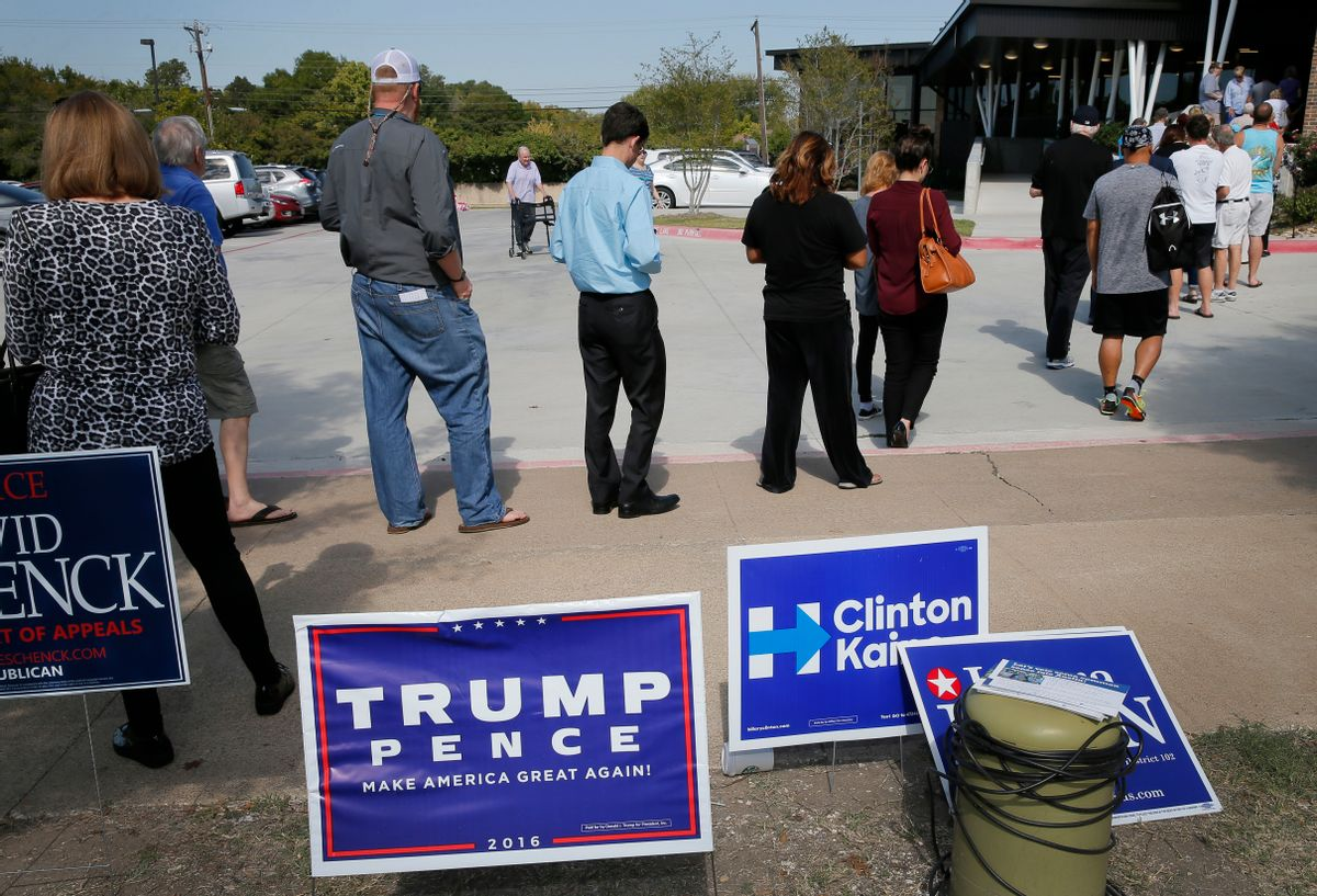 Early voters stand by campaign signage as they wait in line at a voting location, Thursday, Oct. 27, 2016, in Dallas. Republican presidential candidate Donald Trump is again raising the possibility of election rigging in a tweet that follows unsubstantiated claims in Texas of voters having their ballots changed.(AP Photo/Tony Gutierrez) (AP)