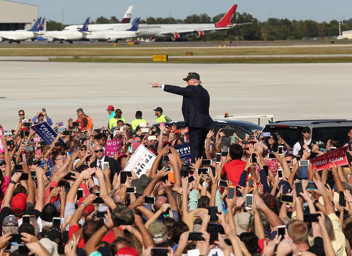 Donald Trump waves to cheering supporters at a Trump rally at Sanford Orlando International Airport in Sanford, Fla.,Tuesday, Oct. 25, 2016.  (AP)