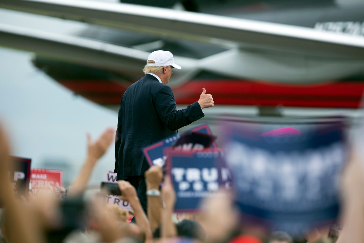 Republican presidential candidate Donald Trump walks to his plane after speaking during a campaign rally, Wednesday, Oct. 12, 2016, in Lakeland, Fla. (AP Photo/ Evan Vucci) (AP)
