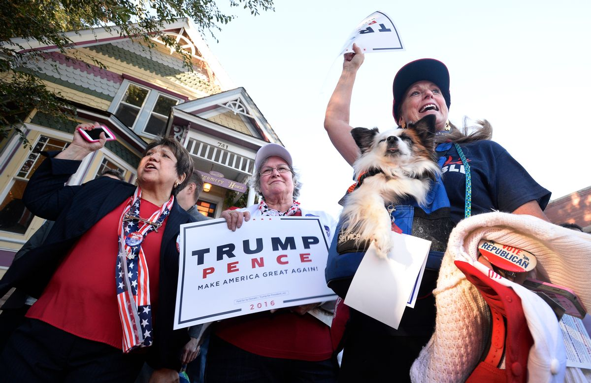 Republican presidential candidate Donald Trump supporters Mary Claire, from left, Colette McDonald and Karolee McLaughlin, with her dog Lakota, spar with protesters during an appearance by Donald Trump Jr., a son of presidential candidate Donald Trump, in Boulder, Colo., Monday, Oct. 17, 2016. (Paul Aiken/Daily Camera via AP) (AP)