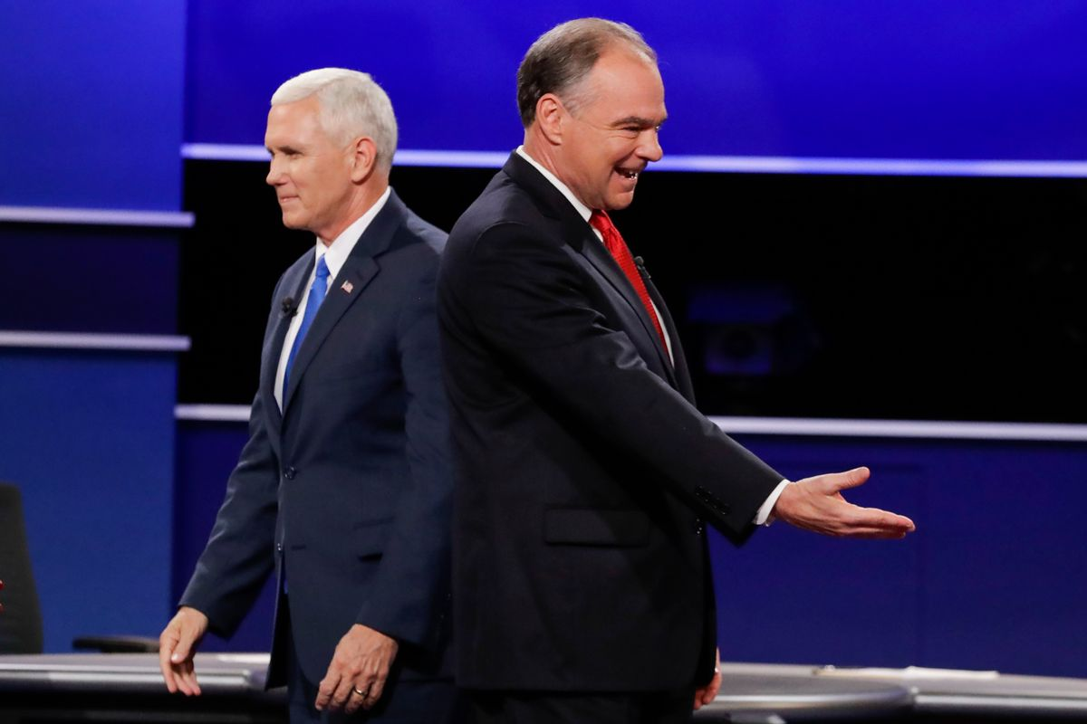 Republican vice-presidential nominee Gov. Mike Pence and Democratic vice-presidential nominee Sen. Tim Kaine, right, walk past each other after the vice-presidential debate at Longwood University in Farmville, Va., Tuesday, Oct. 4, 2016. (AP Photo/David Goldman) (AP)