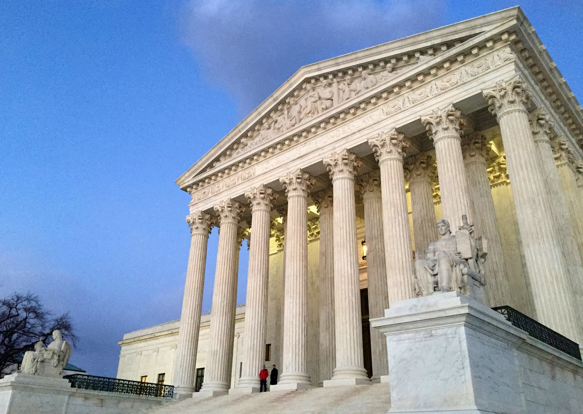 FILE - In this Feb. 13, 2016, file photo, people stand on the steps of the Supreme Court at sunset in Washington. The ideological direction of the Supreme Court is going to tip one way or the other after the election.  (AP)