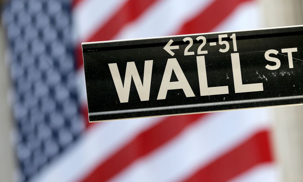 In this Tuesday, Sept. 8, 2015, file photo, a Wall Street street sign is framed by an American flag hanging on the facade of the New York Stock Exchange.  (AP Photo/Mary Altaffer, File)