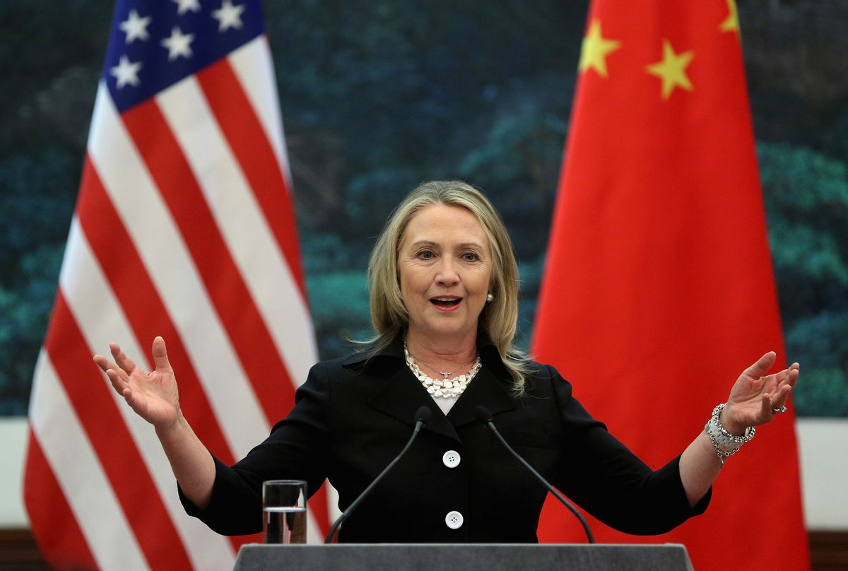 """FILE - In this Sept. 5, 2012 file photo, then U.S. Secretary of State Hillary Clinton speaks during her joint conference with Chinese Foreign Minister Yang Jiechi at the Great Hall of the People in Beijing when talks between Clinton and Chinese leaders failed to narrow gaps on how to end the crisis in Syria and how to resolve Beijing's territorial disputes with its smaller neighbors over the South China Sea. Clinton privately said the U.S. would """"ring China with missile defense"""" if the Chinese government failed to curb North Korea's nuclear program, a potential hint at how the former secretary of state would act if elected president. Clinton's remarks were revealed by WikiLeaks in a hack of the Clinton campaign chairman's personal account. (Feng Li/Pool Photo via AP, File) (AP)"""
