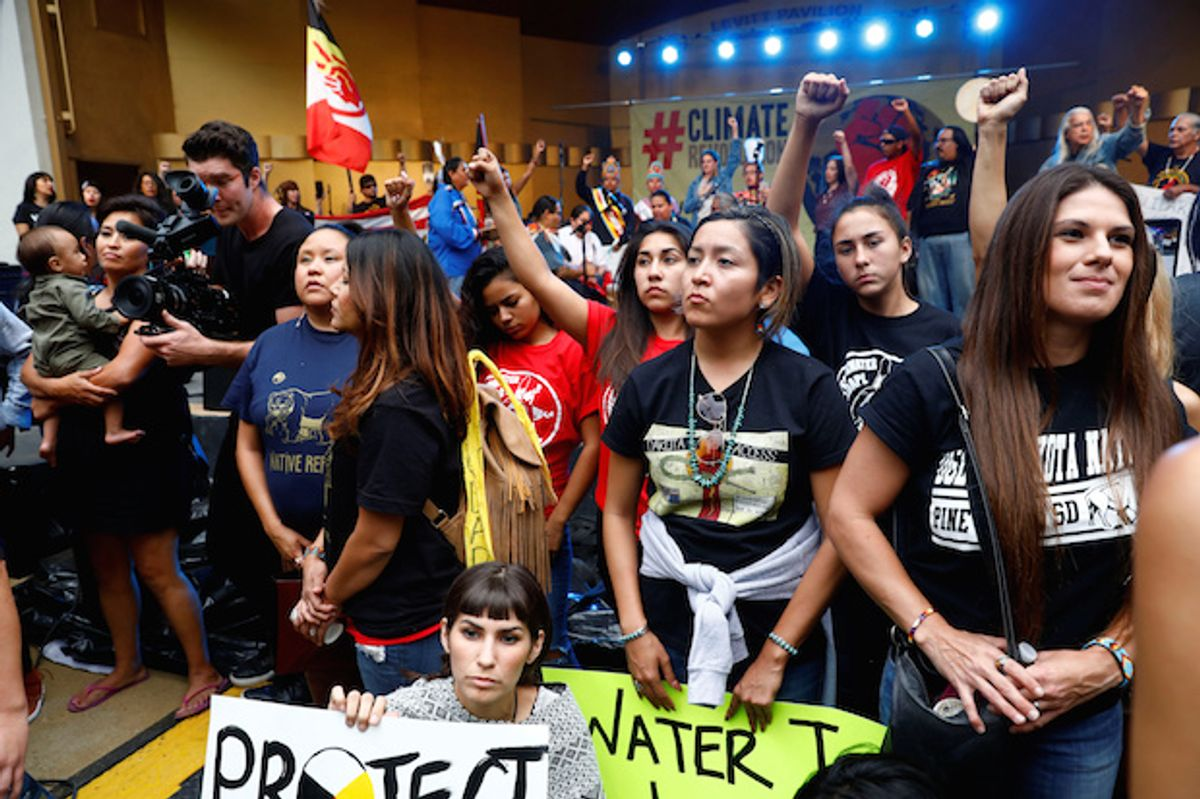 Activists at a climate change rally in solidarity with protests of against the Dakota Access pipeline, in Los Angeles, California on October 23, 2016  (Reuters/Patrick T. Fallon)