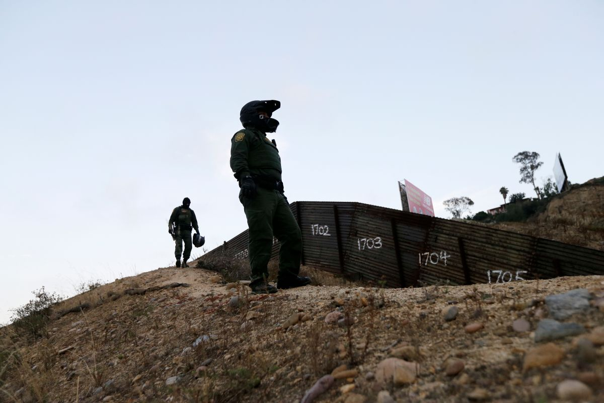 FILE - In this Wednesday, June 22, 2016, file photo, Border Patrol agents look over the primary fence separating Tijuana, Mexico, right, and San Diego in San Diego.  (AP)