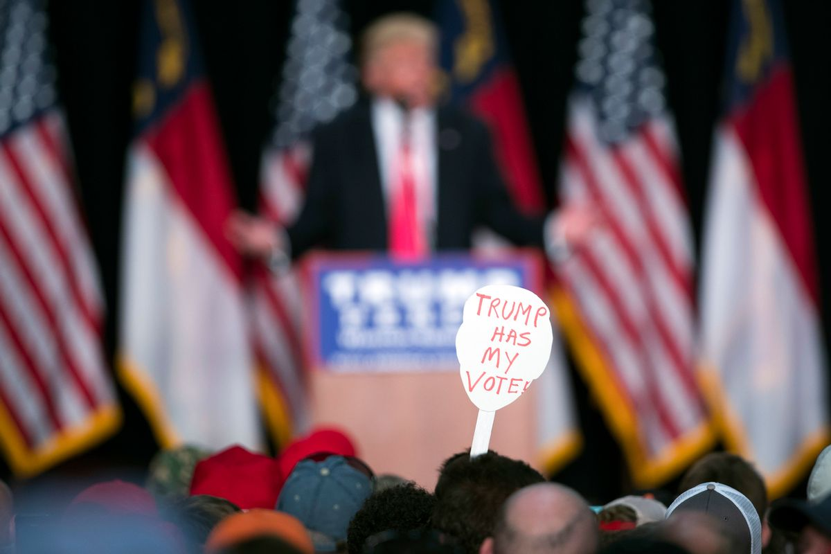 FILE - In this Monday, July 25, 2016 file photo, a supporter of Republican presidential candidate Donald Trump holds a sign during a campaign rally in Winston-Salem, N.C. A Kaiser Family Foundation-CNN poll released in September 2016 compared white college graduates and the white, black and Hispanic working class. Working-class whites were least likely to say that they're satisfied with their influence in the political process, that the federal government represents their views, and that they believe their children will achieve a better standard of living than themselves. (AP Photo/Evan Vucci) (AP)