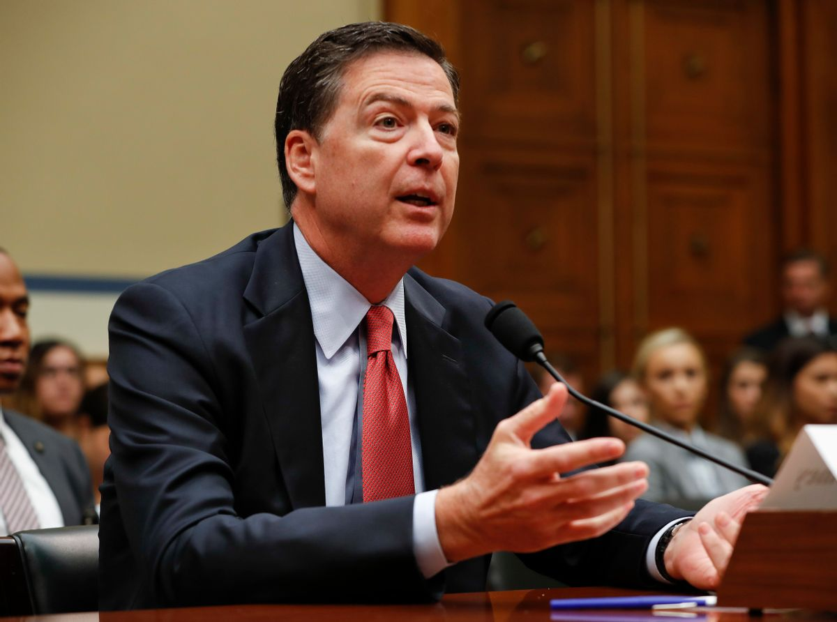 """FILE - In this Sept. 28, 2016 file photo, FBI Director James Comey testifies on Capitol Hill in Washington. A Homeland Security Department official says hackers have targeted the voter registration systems of more than 20 states in recent months. Comey told lawmakers this week that the agency is looking """"very, very hard"""" at Russian hackers who may try to disrupt the U.S. election.  (AP Photo/Pablo Martinez Monsivais, File) (AP)"""