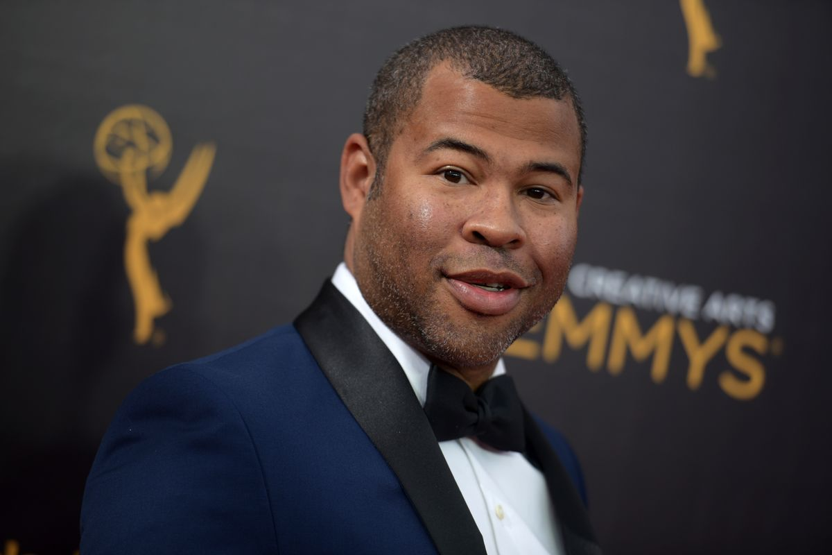 """FILE - In this Sept. 11, 2016, file photo, Jordan Peele arrives at night two of the Creative Arts Emmy Awards in Los Angeles. The trailer for Peele's upcoming film, """"Get Out,"""" debuted online on Oct. 4, 2016. (Photo by Richard Shotwell/Invision/AP, File) (AP)"""