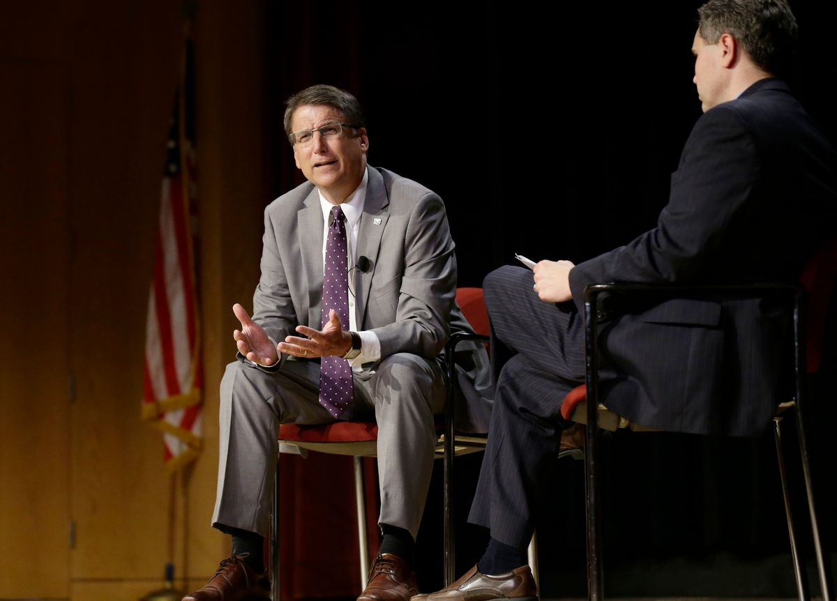 In this photo taken Wednesday, May 4, 2016 North Carolina Gov. Pat McCrory, left, make remarks concerning House Bill 2 while speaking during a government affairs conference in Raleigh, N.C. The North Carolina governor's race is everything voters anticipated it would be: expensive attack ads and barbed debates before what's essentially a referendum on the state's recent rightward tilt under Republican rule, particularly the state law limiting protections for LGBT people _ known as House Bill 2. (AP Photo/Gerry Broome, File) (AP)