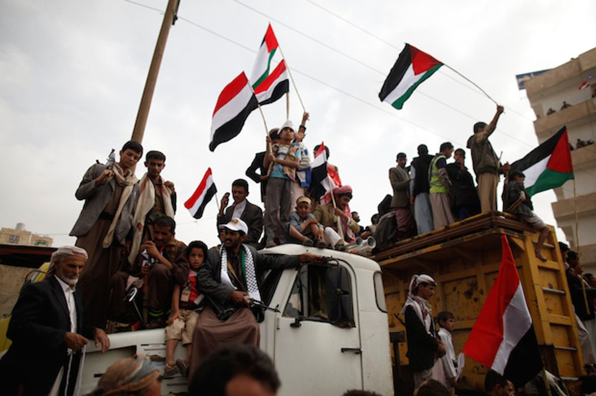 Supporters of Yemen's Houthi rebels stand atop a truck as they demonstrate to mark the annual Al-Quds Day in the capital Sana'a, on July 1, 2016  (Reuters/Khaled Abdullah)